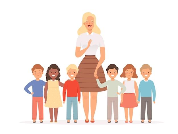 Maestra con niños. grupo de jóvenes alumnos de pie en la escuela con su concepto de educación de jóvenes profesores.