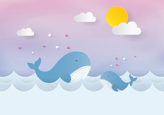 Mamá y bebé ballena en el mar, corte de papel