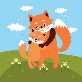Mamá y bebé zorro abrazan en el prado