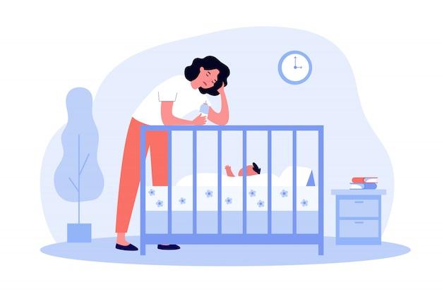 Mamá cansada deprimida dando biberón al bebé