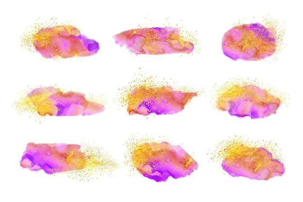 Manchas de acuarela con oro y purpurina.