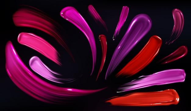 Manchas de lápiz labial, esmalte de uñas o pintura conjunto aislado sobre fondo negro.