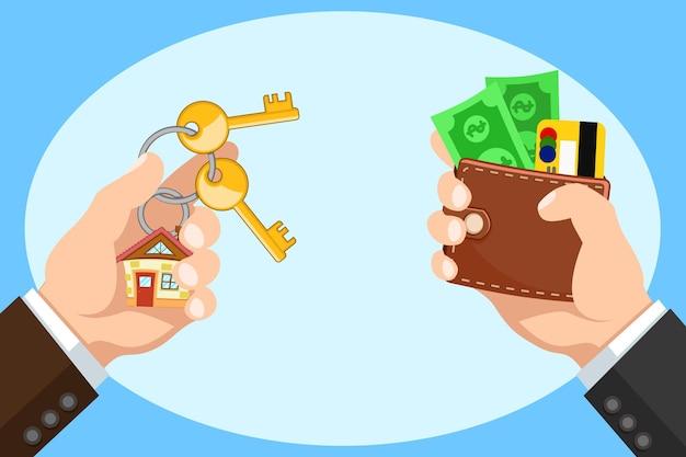 De la mano con una billetera y llaves para una nueva casa, compra de bienes raíces. comprar casa