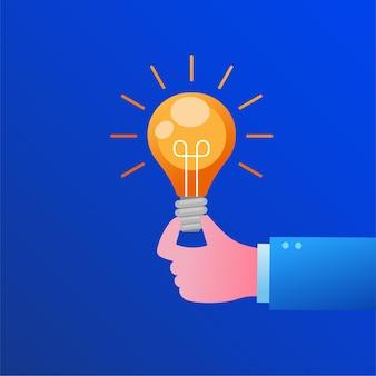 Mano con bombilla de luz de lluvia de ideas concepto plano ilustración vectorial banner y página de destino