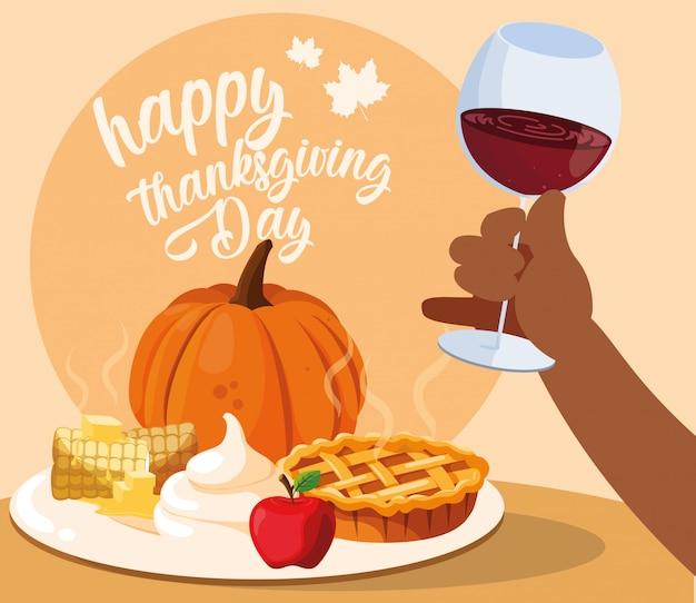 Mano con copa de vino y comida de acción de gracias