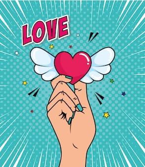 Mano y corazón con alas estilo pop art