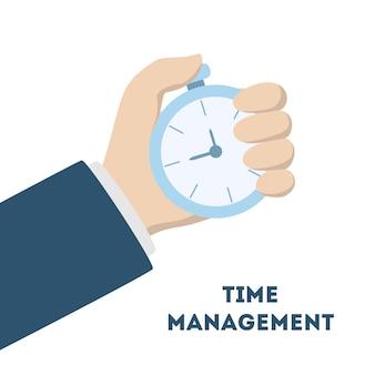 Mano con cronómetro. idea de gestión del tiempo.