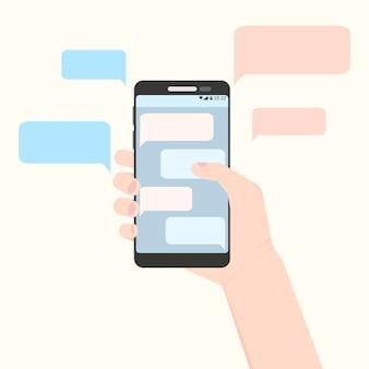 Mano derecha que sostiene el teléfono inteligente con nubes de mensajes