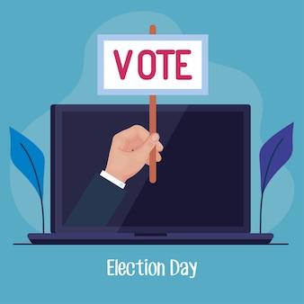 Mano del día de las elecciones que sostiene el cartel de voto en el diseño de la computadora portátil, el gobierno del presidente y el tema de la campaña