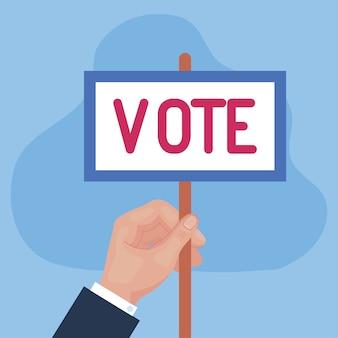 Mano del día de las elecciones que sostiene el diseño del cartel de voto, el gobierno del presidente y el tema de la campaña
