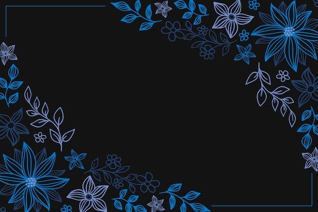 Mano dibuja flores de colores sobre fondo de pizarra