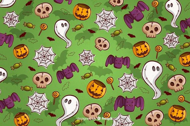 Mano dibuja patrones sin fisuras de fondo de halloween en verde