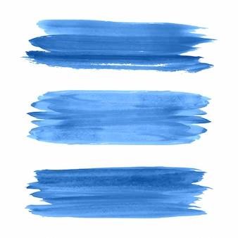 Mano dibujar trazos de acuarela azul set vector