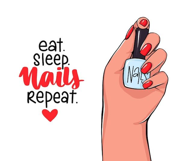 Mano femenina sostiene la botella de esmalte de uñas. letras escritas a mano sobre uñas y manicura.