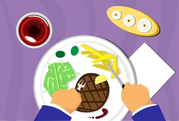 La mano de la gente, restaurante carne estaca plato comida, vista superior del vino