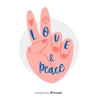 Mano haciendo el símbolo de la paz con caligrafía