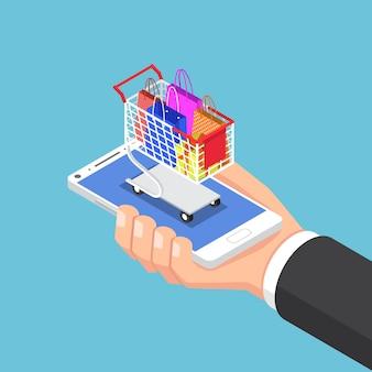 Mano de hombre de negocios isométrica 3d plana con bolsa de compras y carro en el teléfono inteligente. concepto de compra online.