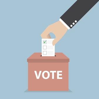Mano de hombre de negocios poniendo papel de votación