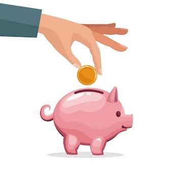 Mano humana depositando monedas en una hucha de dinero