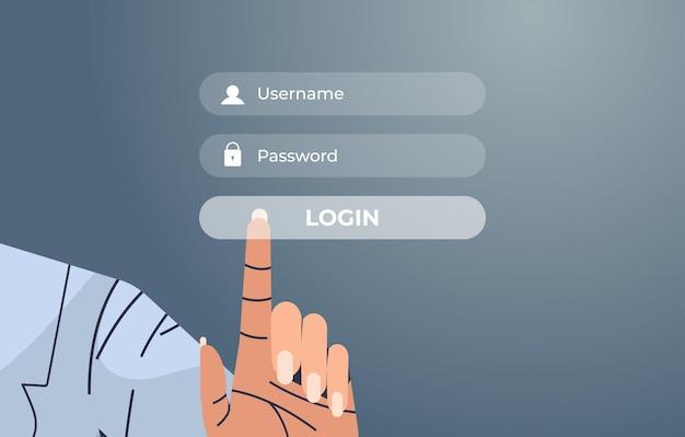Mano humana presionando el botón de inicio de sesión en la pantalla virtual