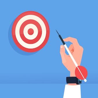 Mano humana sosteniendo flecha golpear objetivo diana éxito objetivo concepto plana