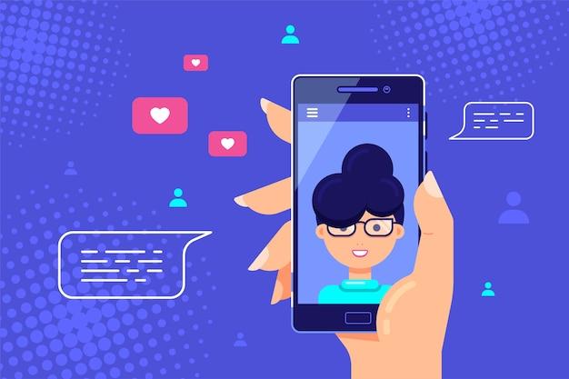 Mano humana sosteniendo smartphone con personaje femenino en pantalla. videollamada, video chat en línea, tecnología de internet.