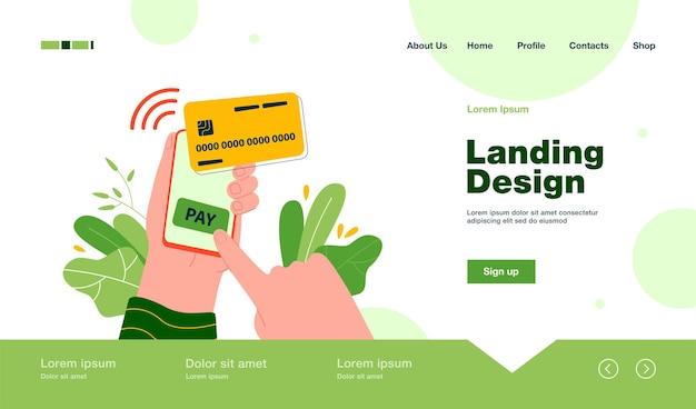 Mano humana sosteniendo un teléfono inteligente y pagando la página de destino en línea en estilo plano