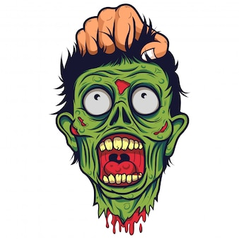 Mano humana sujeta la cabeza de un zombie muerto.