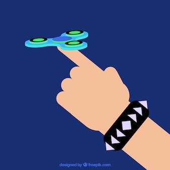 Mano jugando con un spinner azul