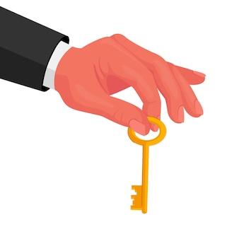 Mano masculina en ropa formal sosteniendo la llave de oro en los dedos aislado sobre fondo blanco.