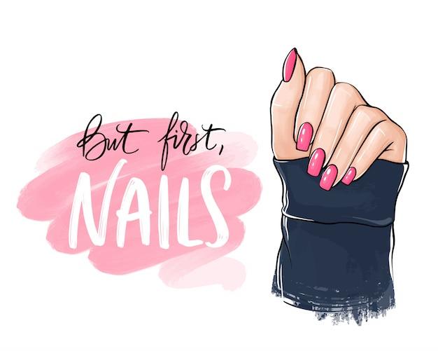 Mano de mujer hermosa con esmalte de uñas rosa. letras escritas a mano sobre las uñas.