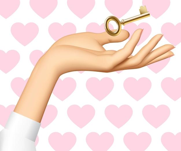 Mano de mujer con una llave de oro aislada