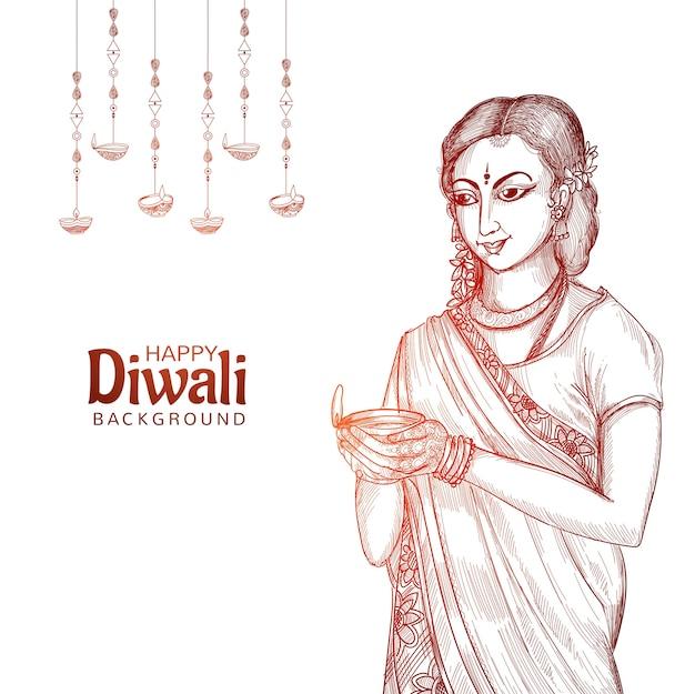 Mano de mujer sosteniendo boceto para fondo de diwali de lámpara de aceite indio