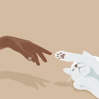 Mano de una niña jugando con un gato blanco