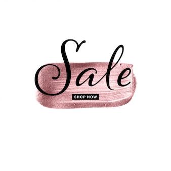 Mano de oro rosa dibujado pincelada con texto de venta