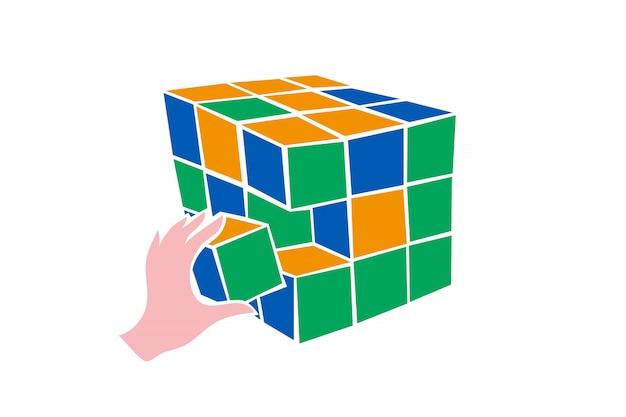 Mano poniendo la última pieza en la estructura cuadrada
