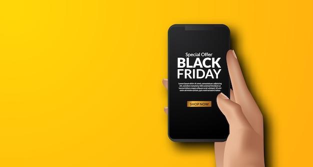Mano que sostiene la aplicación de teléfono para el evento de promoción del viernes negro