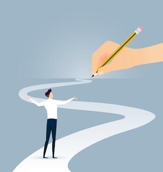 Mano que sostiene el lapiz camino al éxito empresarial