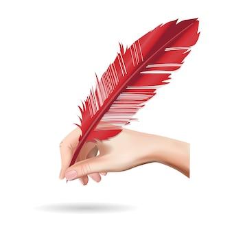 Mano que sostiene la pluma de pluma