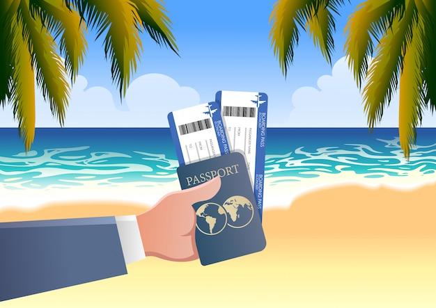 Mano que sostiene la tarjeta de embarque y el pasaporte en el fondo de la playa de vacaciones junto al mar