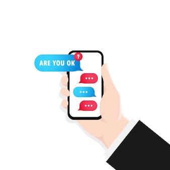 Mano que sostiene el teléfono inteligente con la ilustración de la ventana de diálogo