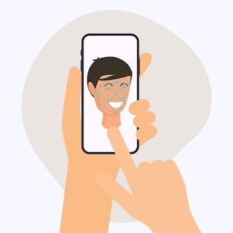 Mano que sostiene el teléfono inteligente móvil con aplicación de reconocimiento facial