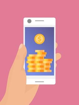 Mano que sostiene el teléfono inteligente móvil con monedas de oro en la pantalla