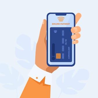 Mano que sostiene el teléfono inteligente y paga en línea