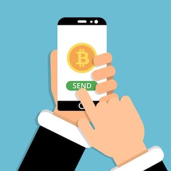 Mano que sostiene el teléfono inteligente con el símbolo de bitcoin en la pantalla. envía bitcoins con un teléfono inteligente, criptomoneda de dinero