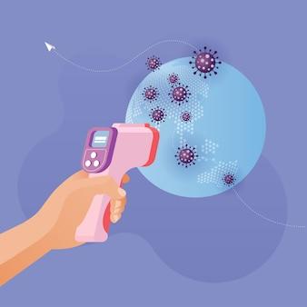 La mano que sostiene el termómetro infrarrojo tiene alta temperatura de calor en el planeta tierra