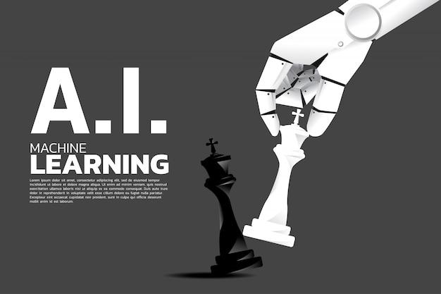 Mano robot que mueve la pieza de ajedrez al jaque mate rey.