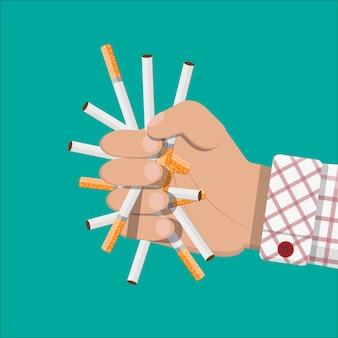 Mano rompe cigarrillos.