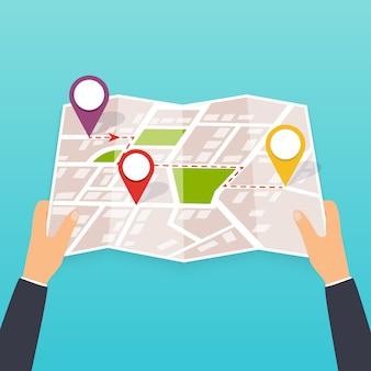 Mano sosteniendo un mapa de papel con puntos. turista mira el mapa de la ciudad. ilustración en formato. concepto de viaje.
