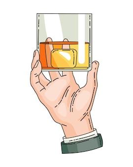 Mano sosteniendo un vaso con whisky de bebida fuerte